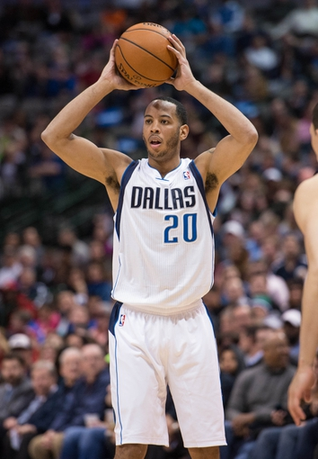 Feb 26, 2014; Dallas, TX, USA; Dallas Mavericks point guard Devin Harris (20) during the game against the New Orleans Pelicans at the American Airlines Center. The Mavericks defeated the Pelicans 108-89. Mandatory Credit: Jerome Miron-USA TODAY Sports