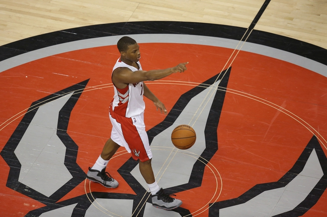 Feb 27, 2014; Toronto, Ontario, CAN; Toronto Raptors point guard Kyle Lowry (7) brings the ball up the court against the Washington Wizards at Air Canada Centre. The Wizards beat the Raptors 134-129 in triple overtime. Mandatory Credit: Tom Szczerbowski-USA TODAY Sports