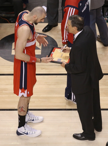 Feb 27, 2014; Toronto, Ontario, CAN; Washington Wizards center Marcin Gortat (4) talks to head coach Randy Wittman during a timeout against the Toronto Raptors at Air Canada Centre. The Wizards beat the Raptors 134-129 in triple overtime. Mandatory Credit: Tom Szczerbowski-USA TODAY Sports