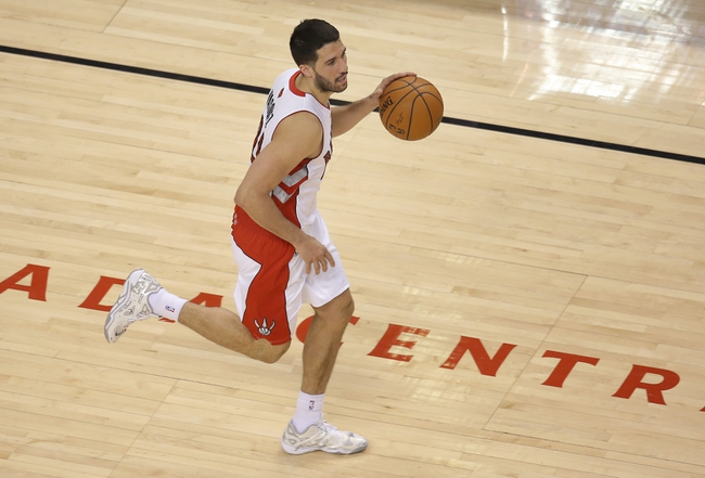Feb 27, 2014; Toronto, Ontario, CAN; Toronto Raptors guard Greivis Vasquez (21) advances the ball against the Washington Wizards at Air Canada Centre. The Wizards beat the Raptors 134-129 in triple overtime. Mandatory Credit: Tom Szczerbowski-USA TODAY Sports