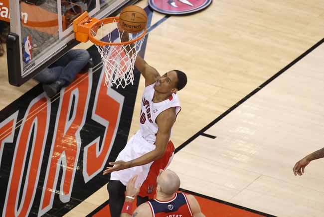Feb 27, 2014; Toronto, Ontario, CAN; Toronto Raptors guard DeMar DeRozan (10) goes to the basket and scores against the Washington Wizards at Air Canada Centre. The Wizards beat the Raptors 134-129 in triple overtime. Mandatory Credit: Tom Szczerbowski-USA TODAY Sports