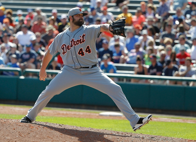 Mar 2, 2014; Lake Buena Vista, FL, USA; Detroit Tigers relief pitcher Joba Chamberlain (44) throws a pitch during the sixth inning against the Atlanta Braves at Champion Stadium. Mandatory Credit: Kim Klement-USA TODAY Sports
