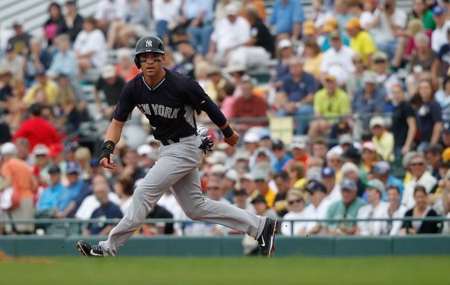 Feb 26, 2014; Bradenton, FL, USA; New York Yankees center fielder Jacoby Ellsbury (22) leads off against the Pittsburgh Pirates at McKechnie Field. Mandatory Credit: Kim Klement-USA TODAY Sports