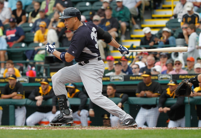 Feb 26, 2014; Bradenton, FL, USA; New York Yankees right fielder Carlos Beltran (36) at bat against the Pittsburgh Pirates at McKechnie Field. Mandatory Credit: Kim Klement-USA TODAY Sports