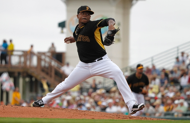 Feb 26, 2014; Bradenton, FL, USA; Pittsburgh Pirates starting pitcher Edinson Volquez (36) throws a pitch during the second inning against the New York Yankees at McKechnie Field. Mandatory Credit: Kim Klement-USA TODAY Sports
