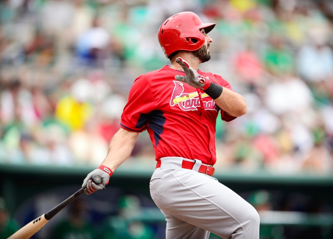 Mar 17, 2014; Fort Myers, FL, USA; St. Louis Cardinals shortstop Daniel Descalso (33) doubles and drives in two runs during the third inning against the Boston Red Sox at JetBlue Park. Mandatory Credit: Jerome Miron-USA TODAY Sports