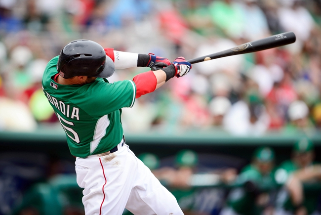 Mar 17, 2014; Fort Myers, FL, USA; Boston Red Sox second baseman Dustin Pedroia (15) hits a two run home run during the third inning at JetBlue Park. Mandatory Credit: Jerome Miron-USA TODAY Sports