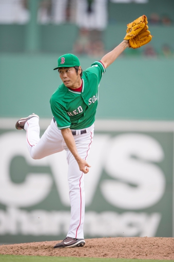 Mar 17, 2014; Fort Myers, FL, USA; Boston Red Sox relief pitcher Koji Uehara (19) pitches against the St. Louis Cardinals during the eighth inning at JetBlue Park. The Boston Red Sox defeated the St. Louis Cardinals 10-5. Mandatory Credit: Jerome Miron-USA TODAY Sports