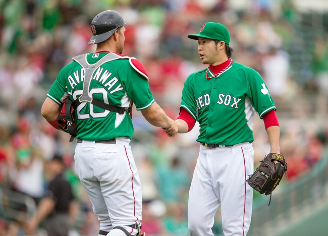 Mar 17, 2014; Fort Myers, FL, USA; Boston Red Sox catcher Ryan Lavarnway (20) and relief pitcher Junichi Tazawa (36) celebrate the win over St. Louis Cardinals at JetBlue Park. The Boston Red Sox defeated the St. Louis Cardinals 10-5. Mandatory Credit: Jerome Miron-USA TODAY Sports