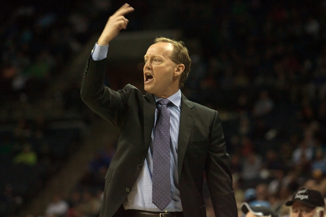 Mar 17, 2014; Charlotte, NC, USA; Atlanta Hawks head coach Mike Budenholzer yells out during the first half against the Charlotte Bobcats at Time Warner Cable Arena. Mandatory Credit: Jeremy Brevard-USA TODAY Sports