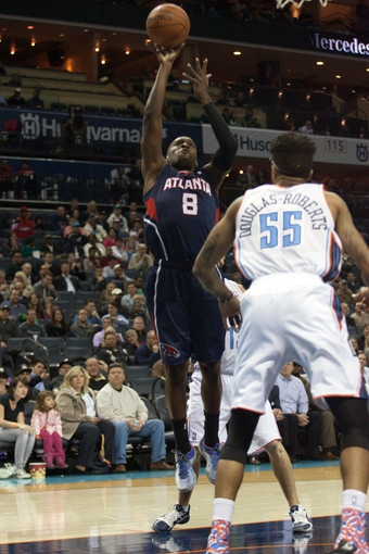 Mar 17, 2014; Charlotte, NC, USA; Atlanta Hawks guard Shelvin Mack (8) shoots the ball during the first half against the Charlotte Bobcats at Time Warner Cable Arena. Mandatory Credit: Jeremy Brevard-USA TODAY Sports
