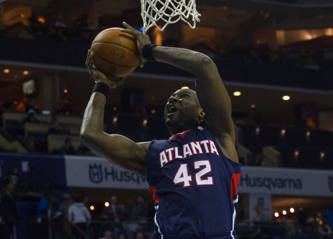 Mar 17, 2014; Charlotte, NC, USA; Atlanta Hawks forward Elton Brand (42) goes up for a shot during the first half against the Charlotte Bobcats at Time Warner Cable Arena. Mandatory Credit: Jeremy Brevard-USA TODAY Sports