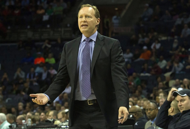 Mar 17, 2014; Charlotte, NC, USA; Atlanta Hawks head coach Mike Budenholzer reacts to a call during the first half against the Charlotte Bobcats at Time Warner Cable Arena. Mandatory Credit: Jeremy Brevard-USA TODAY Sports