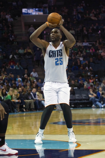Mar 17, 2014; Charlotte, NC, USA; Charlotte Bobcats center Al Jefferson (25) shoots the ball during the second half against the Atlanta Hawks at Time Warner Cable Arena. Atlanta defeated Charlotte 97-83. Mandatory Credit: Jeremy Brevard-USA TODAY Sports