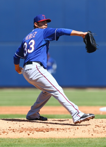 Mar 18, 2014; Phoenix, AZ, USA; Texas Rangers pitcher Martin Perez throws in the first inning against the Milwaukee Brewers at Maryvale Baseball Park. Mandatory Credit: Mark J. Rebilas-USA TODAY Sports