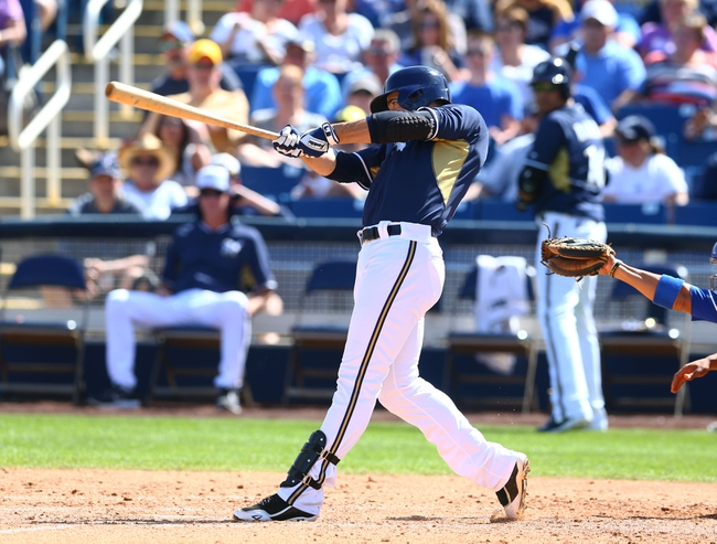 Mar 18, 2014; Phoenix, AZ, USA; Milwaukee Brewers outfielder Ryan Braun drives in a run in the fourth inning against the Texas Rangers at Maryvale Baseball Park. Mandatory Credit: Mark J. Rebilas-USA TODAY Sports