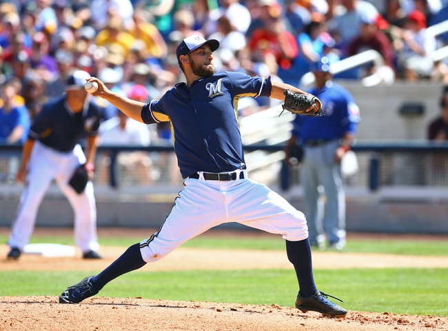 Mar 18, 2014; Phoenix, AZ, USA; Milwaukee Brewers pitcher Marco Estrada throws in the second inning against the Texas Rangers at Maryvale Baseball Park. Mandatory Credit: Mark J. Rebilas-USA TODAY Sports