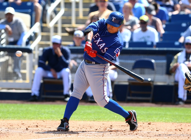 Mar 18, 2014; Phoenix, AZ, USA; Texas Rangers outfielder Shin-Soo Choo bats against the Milwaukee Brewers at Maryvale Baseball Park. Mandatory Credit: Mark J. Rebilas-USA TODAY Sports