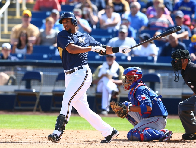 Mar 18, 2014; Phoenix, AZ, USA; Milwaukee Brewers outfielder Carlos Gomez bats in the fourth inning against the Texas Rangers at Maryvale Baseball Park. Mandatory Credit: Mark J. Rebilas-USA TODAY Sports