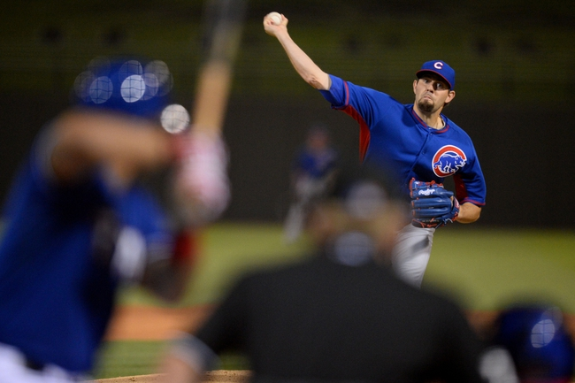 Mar 18, 2014; Surprise, AZ, USA; Chicago Cubs starting pitcher Jason Hammel (39) pitches in the third inning against the Texas Rangers at Surprise Stadium. Mandatory Credit: Joe Camporeale-USA TODAY Sports