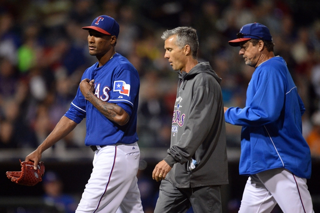 Mar 18, 2014; Surprise, AZ, USA; Texas Rangers starting pitcher Alexi Ogando (41) leaves the game in the fourth inning against the Chicago Cubs at Surprise Stadium. Mandatory Credit: Joe Camporeale-USA TODAY Sports
