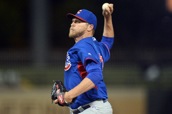 Mar 18, 2014; Surprise, AZ, USA; Chicago Cubs relief pitcher Marcus Hatley (73) pitches in the tenth inning against the Texas Rangers at Surprise Stadium. The Rangers won 7-6 in ten innings. Mandatory Credit: Joe Camporeale-USA TODAY Sports