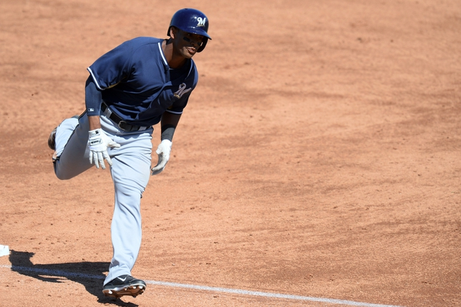 Mar 19, 2014; Peoria, AZ, USA; Milwaukee Brewers left fielder Khris Davis (18) runs the bases after a third inning home run against the Seattle Mariners at Peoria Sports Complex. Mandatory Credit: Joe Camporeale-USA TODAY Sports