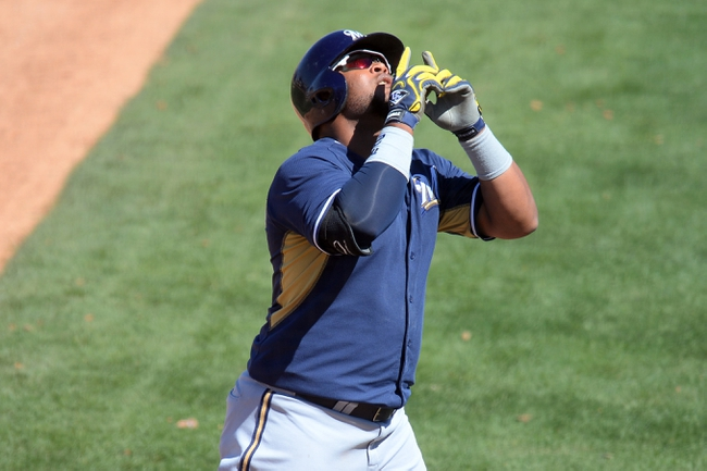 Mar 19, 2014; Peoria, AZ, USA; Milwaukee Brewers first baseman Juan Francisco (21) points to the sky after hitting a home run against the Seattle Mariners at Peoria Sports Complex. Mandatory Credit: Joe Camporeale-USA TODAY Sports