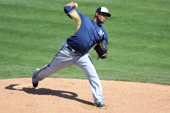 Mar 19, 2014; Peoria, AZ, USA; Milwaukee Brewers starting pitcher Wily Peralta (38) pitches against the Seattle Mariners at Peoria Sports Complex. Mandatory Credit: Joe Camporeale-USA TODAY Sports