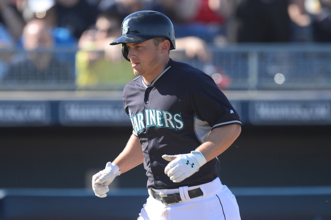 Mar 19, 2014; Peoria, AZ, USA; Seattle Mariners third baseman Kyle Seager (15) runs the bases after hitting a home run in the seventh inning against the Milwaukee Brewers at Peoria Sports Complex. The Brewers won 9-7. Mandatory Credit: Joe Camporeale-USA TODAY Sports