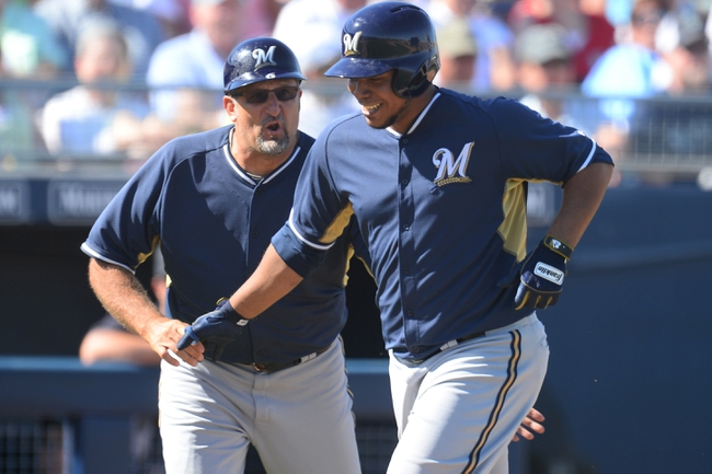 Mar 19, 2014; Peoria, AZ, USA; Milwaukee Brewers starting pitcher Wily Peralta (38) runs the bases after hitting a home run against the Seattle Mariners at Peoria Sports Complex. The Brewers won 9-7. Mandatory Credit: Joe Camporeale-USA TODAY Sports