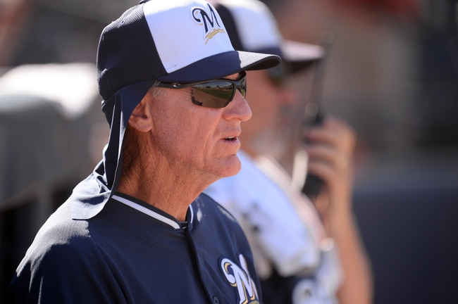 Mar 19, 2014; Peoria, AZ, USA; Milwaukee Brewers manager Ron Roenicke (10) looks on against the Seattle Mariners at Peoria Sports Complex. The Brewers won 9-7. Mandatory Credit: Joe Camporeale-USA TODAY Sports