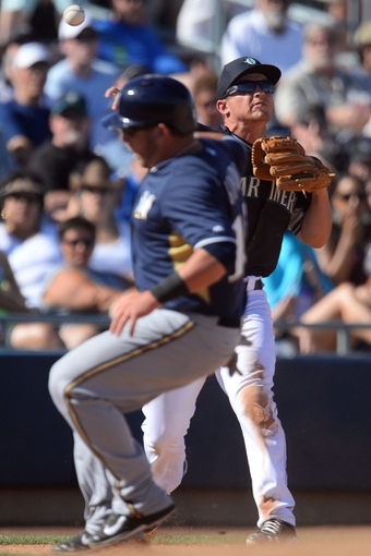 Mar 19, 2014; Peoria, AZ, USA; Seattle Mariners third baseman Kyle Seager (15) throws out a Milwaukee Brewers runner at first base in the seventh inning at Peoria Sports Complex. The Brewers won 9-7. Mandatory Credit: Joe Camporeale-USA TODAY Sports