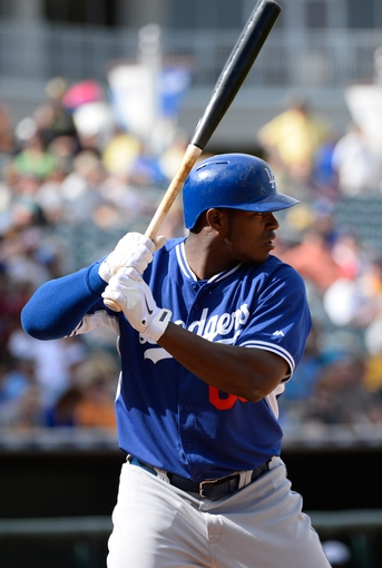 Mar 11, 2014; Surprise, AZ, USA;  Los Angeles Dodgers right fielder Yasiel Puig (66) during an at bat in the seventh inning against the Kansas City Royals at Surprise Stadium. Mandatory Credit: Christopher Hanewinckel-USA TODAY Sports
