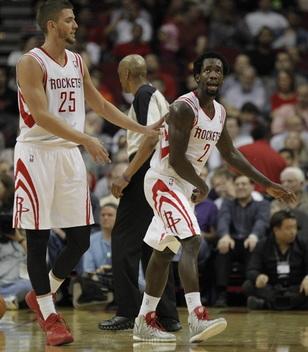 Mar 20, 2014; Houston, TX, USA; Houston Rockets forward Chandler Parsons (25) and guard Patrick Beverley (2) reacts to a play during the second quarter against the Minnesota Timberwolves at Toyota Center. Mandatory Credit: Andrew Richardson-USA TODAY Sports