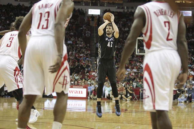 Mar 20, 2014; Houston, TX, USA; Minnesota Timberwolves forward Kevin Love (42) shoots the ball during the third quarter against the Houston Rockets at Toyota Center. Mandatory Credit: Andrew Richardson-USA TODAY Sports