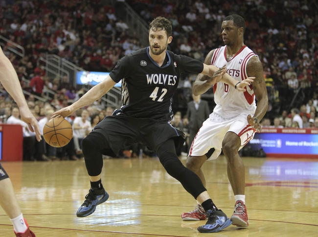 Mar 20, 2014; Houston, TX, USA; Minnesota Timberwolves forward Kevin Love (42) drives to the basket against Houston Rockets forward Terrence Jones (6) during the third quarter at Toyota Center. Mandatory Credit: Andrew Richardson-USA TODAY Sports