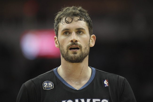 Mar 20, 2014; Houston, TX, USA; Minnesota Timberwolves forward Kevin Love (42) on the court during the third quarter against the Houston Rockets at Toyota Center. Mandatory Credit: Andrew Richardson-USA TODAY Sports