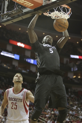 Mar 20, 2014; Houston, TX, USA; Minnesota Timberwolves center Gorgui Dieng (5) dunks the ball during the fourth quarter against the Houston Rockets at Toyota Center. Mandatory Credit: Andrew Richardson-USA TODAY Sports