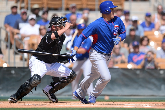 Mar 21, 2014; Phoenix, AZ, USA; Chicago Cubs first baseman Anthony Rizzo (44) runs to first base after making contact in the first inning against the Chicago White Sox at Camelback Ranch. Mandatory Credit: Joe Camporeale-USA TODAY Sports