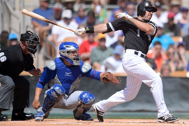 Mar 21, 2014; Phoenix, AZ, USA; Chicago White Sox left fielder Adam Eaton (1) follows through on a swing in the first inning against the Chicago Cubs at Camelback Ranch. Mandatory Credit: Joe Camporeale-USA TODAY Sports