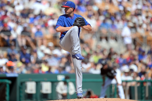 Mar 21, 2014; Phoenix, AZ, USA; Chicago Cubs starting pitcher Chris Rusin (18) pitches against the Chicago White Sox in the first inning at Camelback Ranch. Mandatory Credit: Joe Camporeale-USA TODAY Sports
