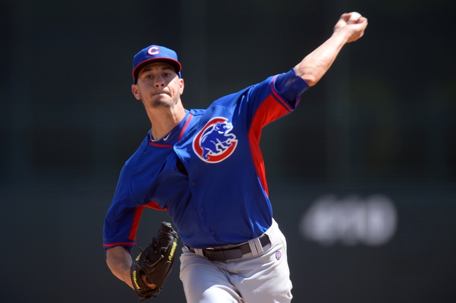 Mar 21, 2014; Phoenix, AZ, USA; Chicago Cubs starting pitcher Chris Rusin (18) pitches against the Chicago White Sox at Camelback Ranch. Mandatory Credit: Joe Camporeale-USA TODAY Sports