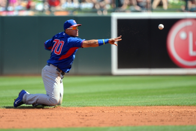 Mar 21, 2014; Phoenix, AZ, USA; Chicago Cubs infielder Javier Baez (70) flips a ball to second base to force out a Chicago White Sox runner at Camelback Ranch. Mandatory Credit: Joe Camporeale-USA TODAY Sports