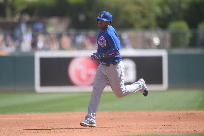 Mar 21, 2014; Phoenix, AZ, USA; Chicago Cubs third baseman Luis Valbuena (24) runs the bases after hitting a home run against the Chicago White Sox at Camelback Ranch. Mandatory Credit: Joe Camporeale-USA TODAY Sports