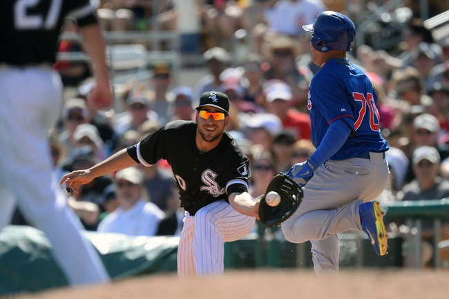 Mar 21, 2014; Phoenix, AZ, USA; Chicago Cubs infielder Javier Baez (70) beats a throw to Chicago White Sox first baseman Alex Liddi (60) at Camelback Ranch. The Cubs won 7-0. Mandatory Credit: Joe Camporeale-USA TODAY Sports