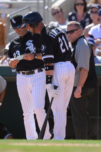 Mar 21, 2014; Phoenix, AZ, USA; Chicago White Sox manager Robin Ventura (23) looks on as Chicago White Sox catcher Tyler Flowers (21) leaves the game during an at bat with an injury at Camelback Ranch. The Cubs won 7-0. Mandatory Credit: Joe Camporeale-USA TODAY Sports