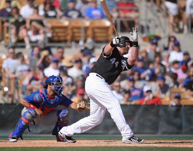 Mar 21, 2014; Phoenix, AZ, USA; Chicago White Sox designated hitter Adam Dunn (44) hits a single against the Chicago Cubs at Camelback Ranch. The Cubs won 7-0. Mandatory Credit: Joe Camporeale-USA TODAY Sports