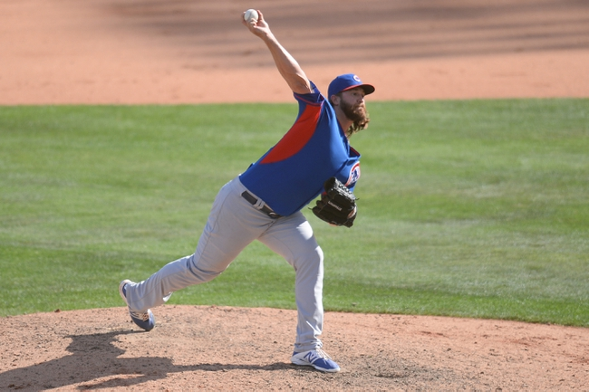 Mar 21, 2014; Phoenix, AZ, USA; Chicago Cubs pitcher Brian Schlitter (63) pitches in the ninth inning against the Chicago White Sox at Camelback Ranch. The Cubs won 7-0. Mandatory Credit: Joe Camporeale-USA TODAY Sports
