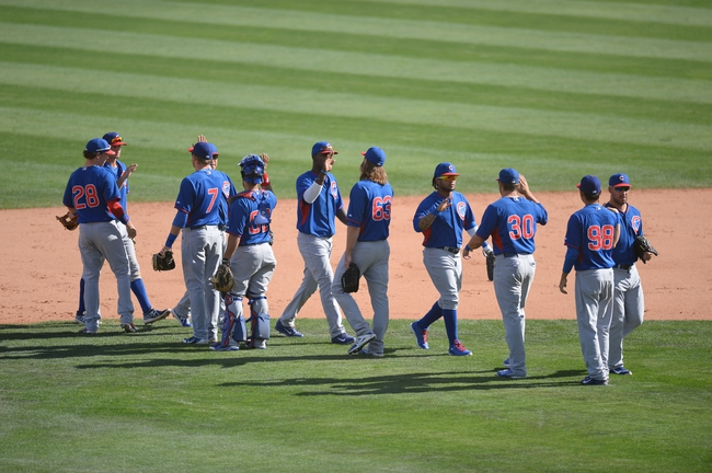 Mar 21, 2014; Phoenix, AZ, USA; The Chicago Cubs celebrate their win over the Chicago White Sox at Camelback Ranch. The Cubs won 7-0. Mandatory Credit: Joe Camporeale-USA TODAY Sports